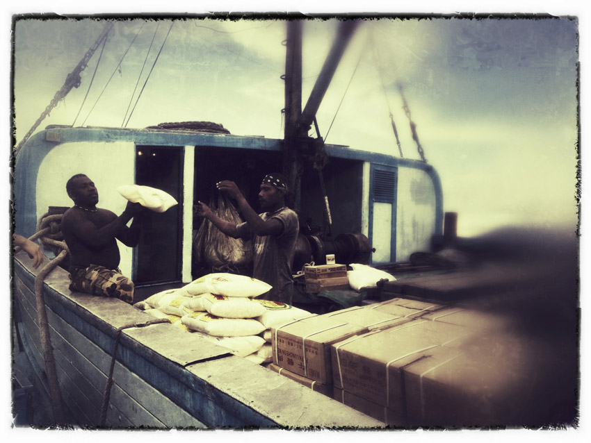 Ship workers loading rice, The Solomon Islands