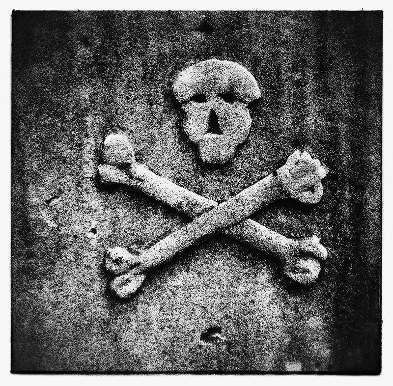 Skull & Bones detail from Headstone, Norfolk Island. photo: Russell Shakespeare