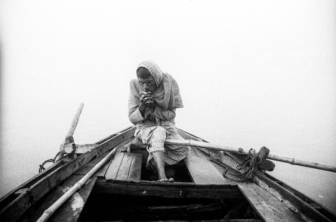 Boatman of Varanasi, Munna Lal enjoying a well deserved cigarette break. photo copyright : Russell Shakespeare